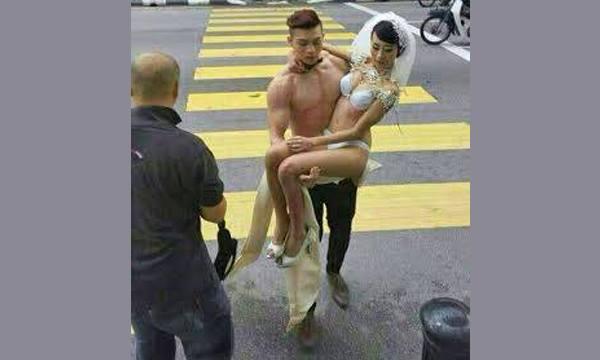 马来西亚怡保半裸男女模特认罪罚马币四百