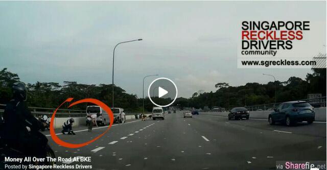 新加坡快速公路(BKE)上,发现遍地都是令吉钞票,不少路过者下车捡钱!