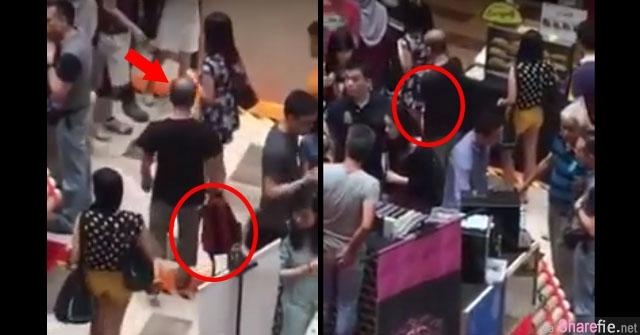 吉隆坡Publika购物商场男子拿着书包尾随偷拍女生裙底 他没想到干案过程早已被人发现拍了下来