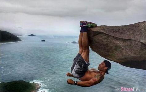 这张跌下去就粉身碎骨的石头悬崖玩命照片?被网友捉包原来是...