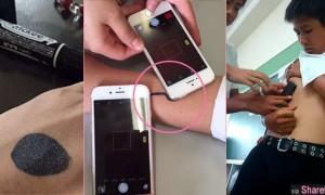 日本最新流行手机恶作剧  只要拿着手机闪光灯对皮肤上的黑点拍照就会让人痛到惊声尖叫!