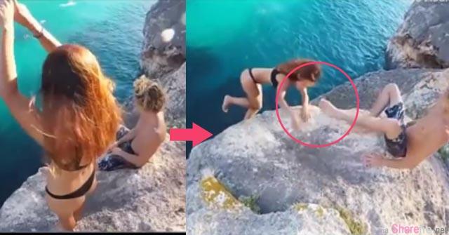 超危险!这名女子挑战悬崖跳水突反悔 但男友竟然缩脚让女子坠入海