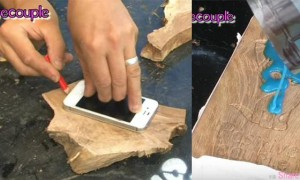 他在木头上画出手机大小然后倒入荧光液体  当他把灯关掉后你一定会吵着也想要一个