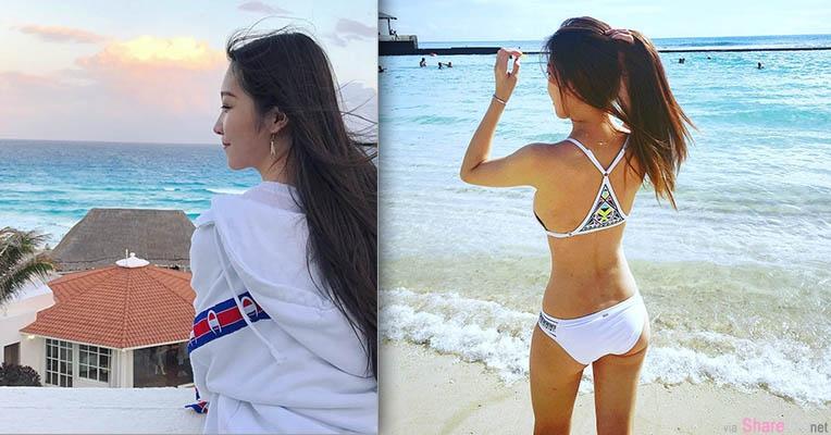 沙滩美景让人忘不了的是她的背影