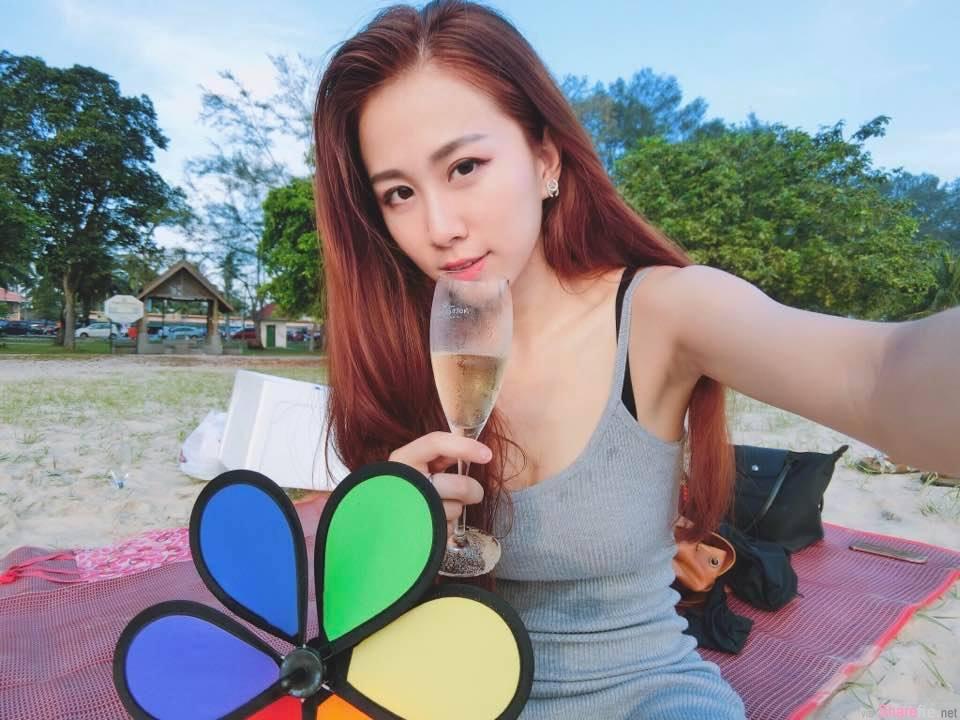 大马正妹Christine Pang 沙滩拍美照 姿势超专业想当摄影师
